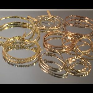 8 mixed size hoop earring. All New